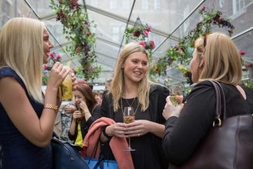 girls socialising at a corporate summer party