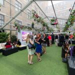 Guests enjoy a company summer party at The Brewery in London