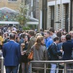 A large crowd enjoys a company summer party at The Brewery venue in London