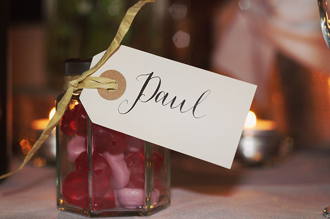 A weeding tag with the name Paul written on it
