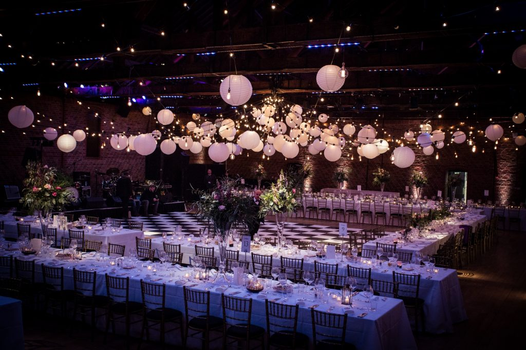 Large room set out for an entertaining wedding