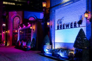 The Brewery conference venue lit up at night